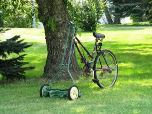 A push lawn mower attached to a bicycle