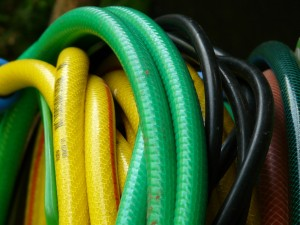 Different sizesed and colored garden hose