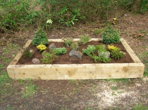 A freshly planted raised garden bed.